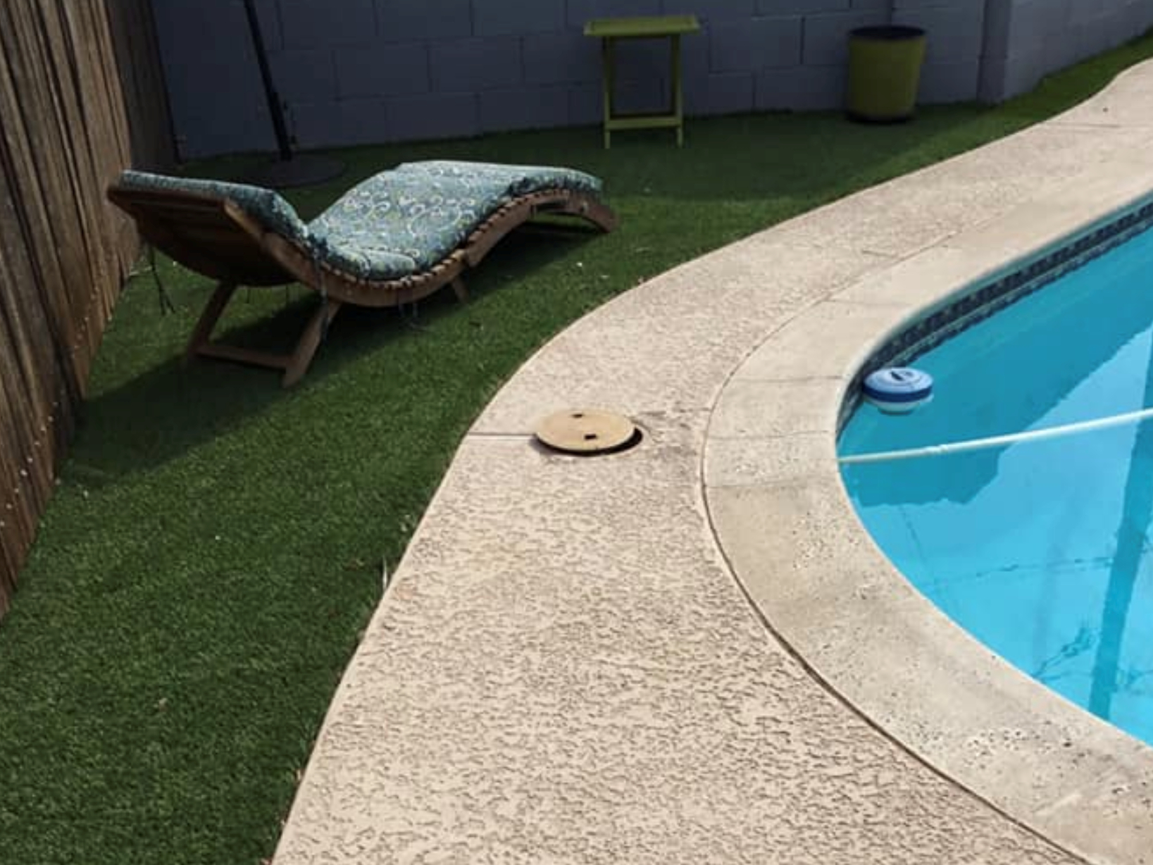 this image shows pool deck in Carlsbad, California